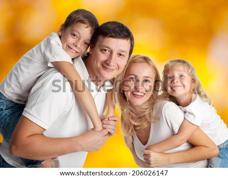 Family with two children outdoors - stock photo