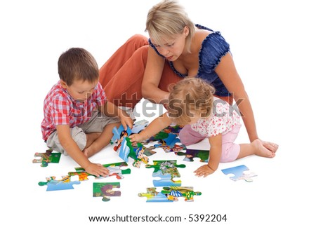 Family, woman and kids, playing with puzzle on the floor - isolated - stock photo