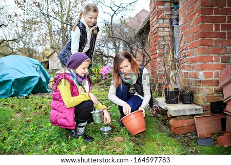 family working in the garden - stock photo