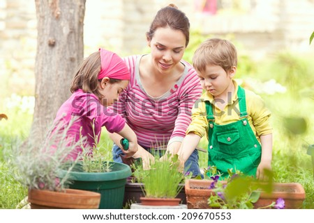 Family working together in a garden - stock photo