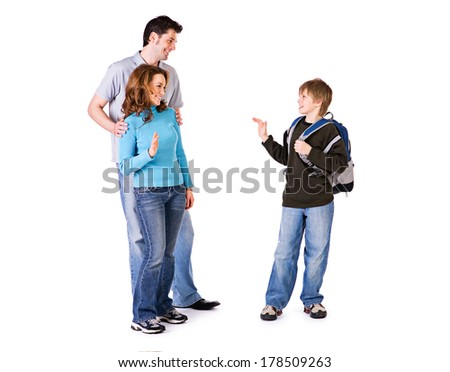 Family: Young Boy Student Waves Goodbye - stock photo