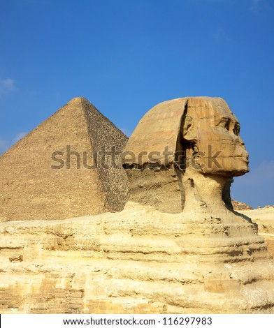 famous ancient egypt Cheops pyramid and sphinx in Giza - stock photo
