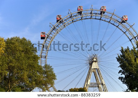 Famous and historic Ferris Wheel of vienna prater park called Wurstelprater - stock photo