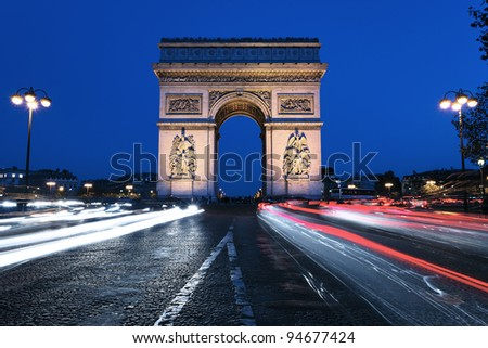 famous Arc de Triomphe by night, Paris France - stock photo