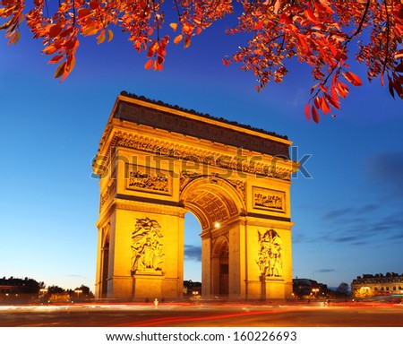 Famous Arc de Triomphe in autumn, Paris, France - stock photo