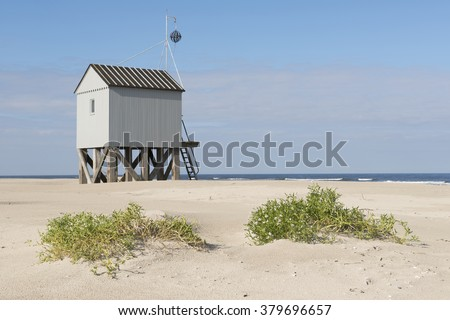 Famous authentic wooden beach hut, for shelter, on the island of Terschelling in the Netherlands. - stock photo
