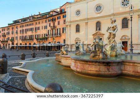 famous Bernini fountain and  Piazza Navona in Rome, Italy - stock photo