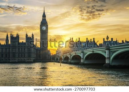 Famous Big Ben clock tower in London at sunset, UK. - stock photo