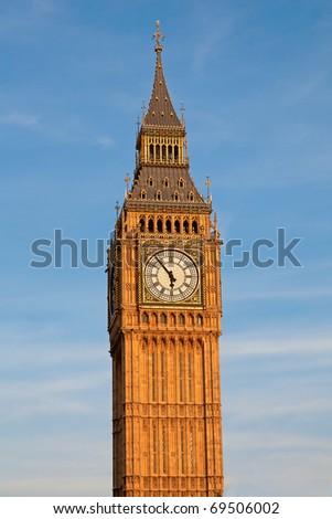 Famous Big Ben clock tower under direct sunset light. London, UK. - stock photo