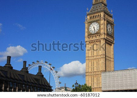 Famous Big Ben clock tower with London eye, in London, UK. - stock photo