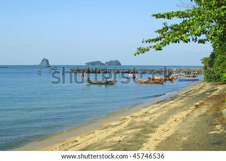 Famous black sand beach on Langkawi island, Malaysia - stock photo