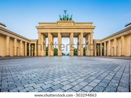 Famous Brandenburger Tor (Brandenburg Gate), one of the best-known landmarks and national symbols of Germany, in beautiful golden morning light at sunrise, Berlin, Germany - stock photo