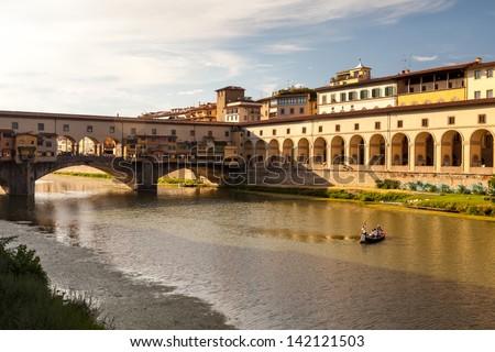 Famous bridge Ponte Vecchio at sunset, Florence, Tuscany, Italy - stock photo