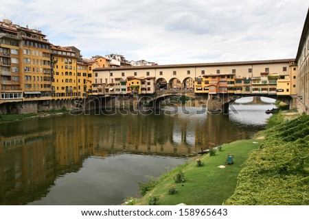 Famous bridge Ponte Vecchio over Arno river in Florence, Italy  - stock photo