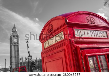 Famous British red telephone box with Big Ben and Double Decker bus at background on a sunny day -black and white version - London, UK - stock photo