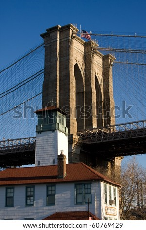 Famous Brooklyn Ice Cream Factory at Fulton Landing in front of Brooklyn Bridge Tower - stock photo