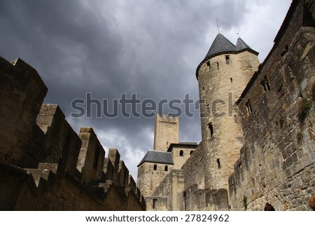 Famous carcassonne castle in France and grey cloudy sky - stock photo
