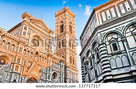 Famous Cathedral Santa Maria Del Fiore with Giotto's Campanile and Baptistery of St. John at sunset on Piazza del Duomo in Florence, Tuscany, Italy - stock photo