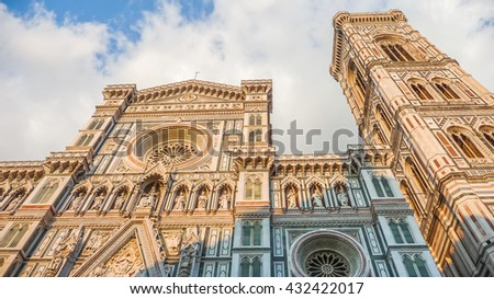 Famous Cathedral Santa Maria Del Fiore with Giotto's Campanile at sunset on Piazza del Duomo in Florence, Tuscany, Italy - stock photo