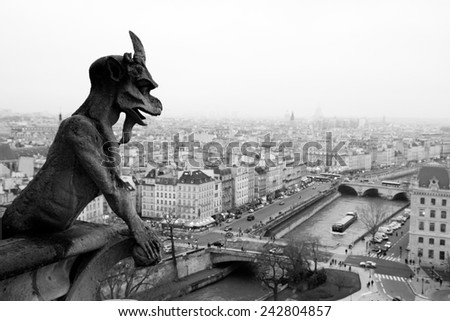 Famous chimere of the Notre-Dame cathedral overlooking Paris - stock photo