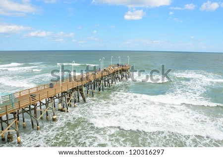 Famous Daytona Beach Florida fishing pier. - stock photo