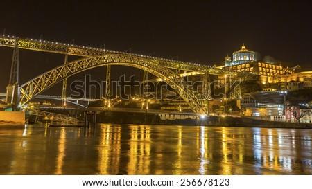 Famous Dom Luis I Bridge at night time in Porto, Portugal. - stock photo