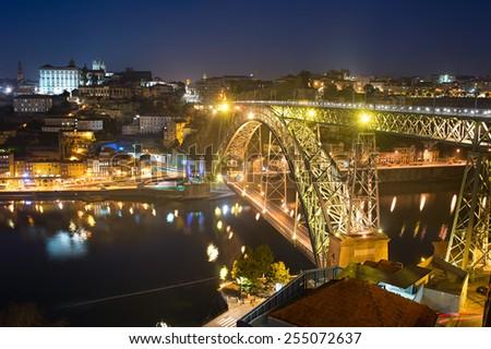 Famous Dom Luis I bridge in Porto at twilight. Portugal - stock photo