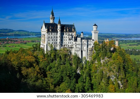 Famous fairy tale Neuschwanstein Castle in Bavaria, Germany, afternoon with blue sky - stock photo