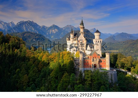 Famous fairy tale Neuschwanstein Castle in Bavaria, Germany,  late afternoon with blue sky with white clouds  - stock photo