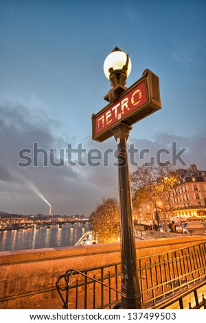 Famous historic Art Nouveau entrance sign for the Metropolitain underground railway system in Paris, France - stock photo