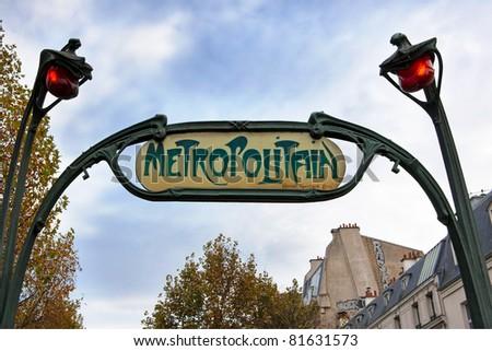Famous historic Art Nouveau entrance sign for the Metropolitain underground railway system in Paris, France. - stock photo