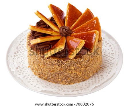 Famous Hungarian Dobos torte - cake with special frosting - isolated on white - stock photo