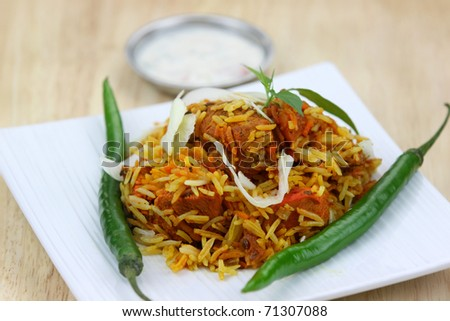 Famous Indian dish chicken biryani made with spices and rice - stock photo