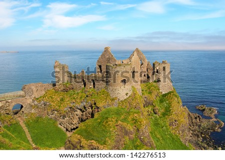 Famous Irish castle of Dunluce rules the coast . Northern Ireland - stock photo