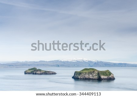 famous island with tiny house, Iceland - stock photo