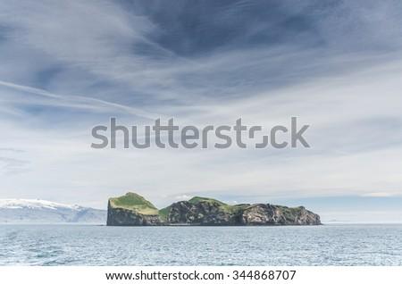 famous island with tiny house, Iceland - stock photo