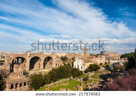 Famous italian landmark: the ancient Roman Forum (Foro Romano) with the Colosseo in background. Rome, Italy, Europe. - stock photo