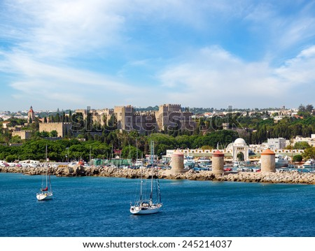 Famous Knight Castle and windmills in Rhodes, Greece - stock photo