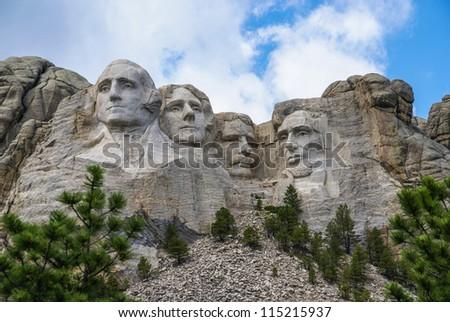 Famous Landmark and Mountain Sculpture - Mount Rushmore, near Keystone, South Dakota.  Shot taken July 2009. - stock photo