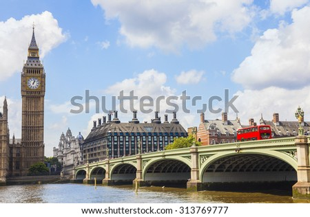 Famous landmark clock tower known as Big Ben and red london double decker bus on Westminster Bridge over the River Thames, London, England - stock photo