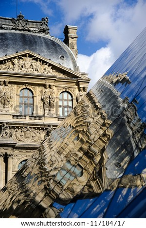 Famous Louvre museum and its reflection - stock photo