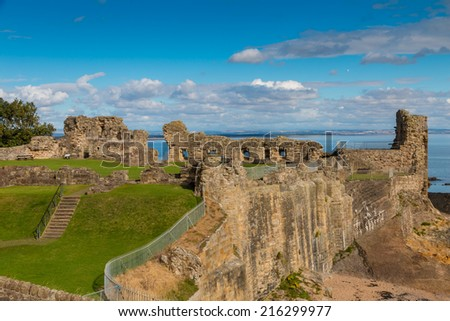 Famous medieval castle on the cliffs of St. Andrews at the east coast of Scotland - stock photo