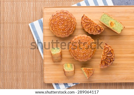 Famous moon cake with assorted nuts and egg yolk.  angle view from above - stock photo