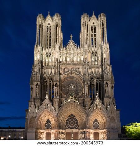 Famous Notre-Dame de Reims at twilight - stock photo