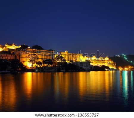 famous palace on lake in Udaipur India at night - stock photo