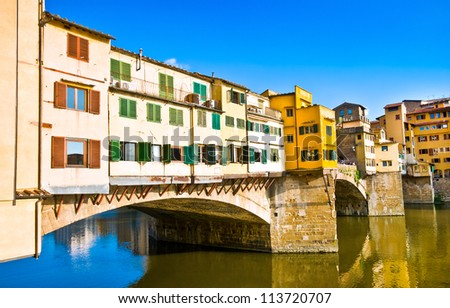 Famous Ponte Vecchio at sunset in Florence, Italy - stock photo