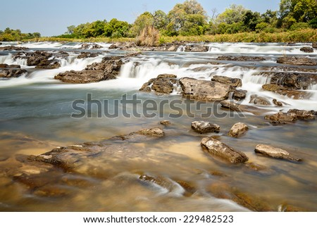 Famous Popa falls in Caprivi, North Namibia, with long exposure - stock photo