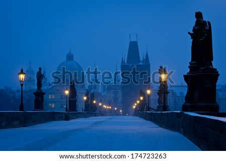 Famous Prague Charles bridge empty at early morning blue hour - stock photo