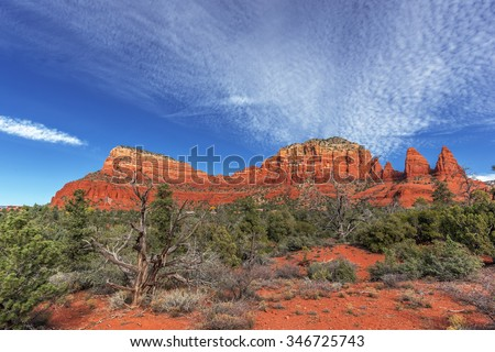 Famous Red Rock Country near Sedona, Arizona. Panoramic vistas. Biking, hiking, and walking trails. Climbing cliffs. Beautiful sunrises and sunsets. Unsurpassed Southwestern landscape colors. - stock photo