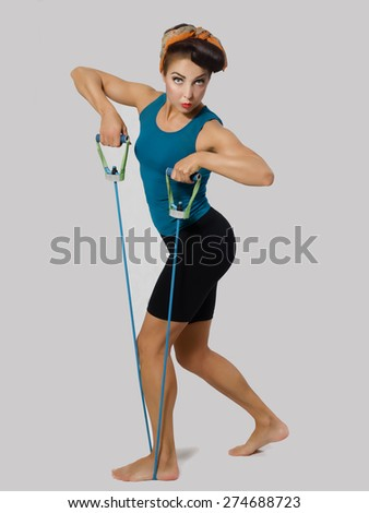 Famous retro pose foto. brunette in a blue shirt with a scarf on her head and hair in a retro style sitting on the splits - stock photo